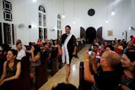 Alexya Salvador (C), a Brazilian trans pastor, walks during a mass in a church in Matanzas, Cuba, May 5, 2017. Picture taken on May 5, 2017. REUTERS/Alexandre Meneghini