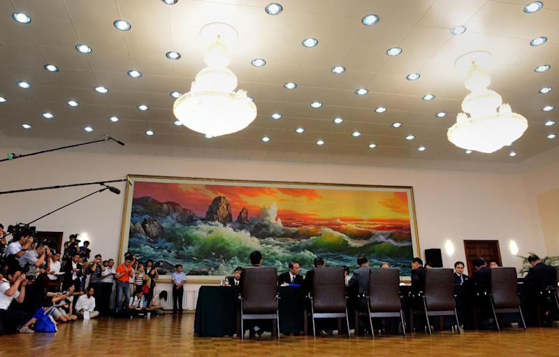 The media look on as members of the North Korean and Japanese delegations hold talks at Pyongyang's Embassy in Beijing on July 1, 2014 (AFP Photo/Goh Chai Hin)