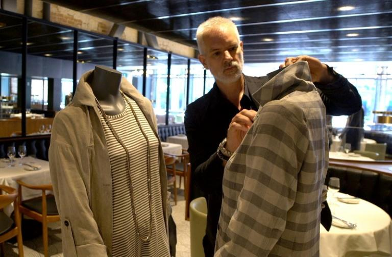 Canadian designer Philippe Dubuc dresses mannequins to be used to provide social distancing at a restaurant in Montreal's Old Town on July 10, 2020, amid the pandemic