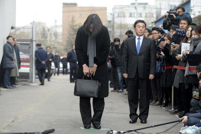 Cho Hyun-ah, also known as Heather Cho, daughter of chairman of Korean Air Lines, Cho Yang-ho, bows in front of the media outside the offices of the Aviation and Railway Accident Investigation Board of the Ministry of Land, Infrastructure, Transport, in Seoul December 12, 2014. Cho, 40, who was an executive at South Korea's flag carrier in charge of in-flight service until she quit this week, was being removed from all posts at affiliate companies. On December 19, while at New York's John F. Kennedy airport, seated in first class on a South Korea-bound flight, she was displeased with being served macadamia nuts in a bag and not a dish. The pilot brought the plane back to its gate for the cabin crew chief to be expelled. REUTERS/Song Eun-seok/News1 (SOUTH KOREA - Tags: TRANSPORT CRIME LAW) ATTENTION EDITORS - NO SALES. NO ARCHIVES. FOR EDITORIAL USE ONLY. NOT FOR SALE FOR MARKETING OR ADVERTISING CAMPAIGNS. THIS IMAGE HAS BEEN SUPPLIED BY A THIRD PARTY. IT IS DISTRIBUTED, EXACTLY AS RECEIVED BY REUTERS, AS A SERVICE TO CLIENTS. SOUTH KOREA OUT. NO COMMERCIAL OR EDITORIAL SALES IN SOUTH KOREA