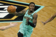 Charlotte Hornets guard Terry Rozier drives to the basket against the Phoenix Suns during the first half of an NBA basketball game on Sunday, March 28, 2021, in Charlotte, N.C. (AP Photo/Chris Carlson)