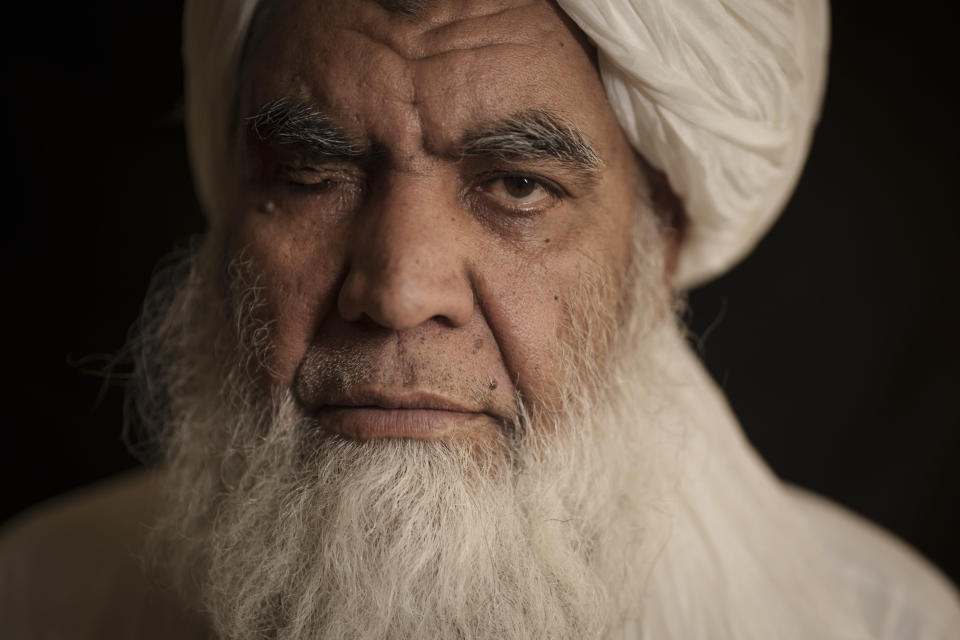 Taliban leader Mullah Nooruddin Turabi poses for a photo in Kabul, Afghanistan, Wednesday, Sept. 22, 2021. Mullah Turabi, one of the founders of the Taliban, says the hard-line movement will once again carry out punishments like executions and amputations of hands, though perhaps not in public. (AP Photo/Felipe Dana)
