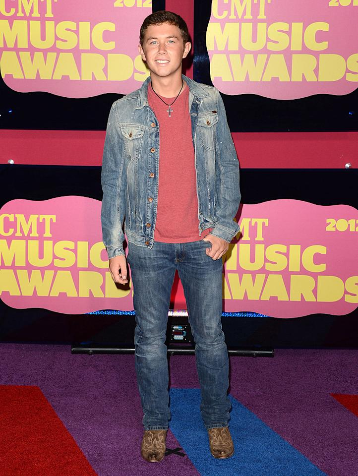 "Scotty McCreery, the Season 10 winner of ""American Idol,"" dressed in denim for the occasion, where he won the USA Weekend Breakthrough Video of the Year Award for ""The Trouble with Girls."""