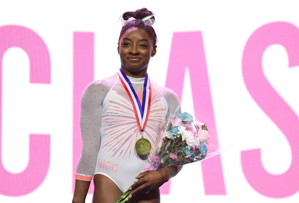 INDIANAPOLIS, INDIANA - MAY 22: Simone Biles smiles after being announced as the overall winner of the 2021 GK U.S. Classic gymnastics competition at the Indiana Convention Center on May 22, 2021 in Indianapolis, Indiana. Biles scored a total of 58.400 points. (Photo by Emilee Chinn/Getty Images)