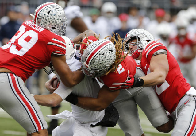 Ohio State defenders, left to right, Malik Harrison, Chase Young and Tuf Borland sack Penn State quarterback Sean Clifford during the first half of an NCAA college football game Saturday, Nov. 23, 2019, in Columbus, Ohio. (AP Photo/Jay LaPrete)