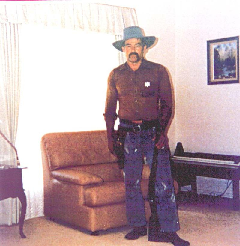 A supplied undated image shows backpacker murderer Ivan Milat posing with a gun.