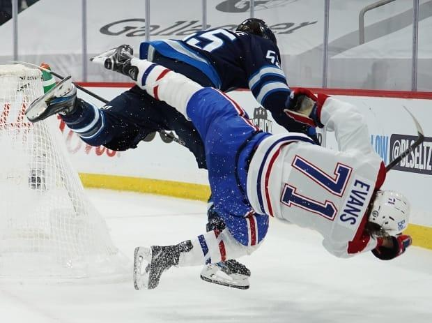 Winnipeg Jets centre Mark Scheifele, left, received a four-game suspension for his vicious hit on Montreal Canadiens forward Jake Evans, right, on Wednesday.  (David Lipnowski/Getty Images - image credit)