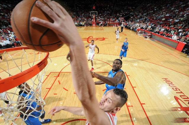 HOUSTON, TX - OCTOBER 21: Donatas Motiejunas #20 of the Houston Rockets dunks the ball against the Dallas Mavericks during a 2013 NBA pre-season game on October 21, 2013 at the Toyota Center in Houston, Texas. (Photo by Bill Baptist/NBAE via Getty Images)