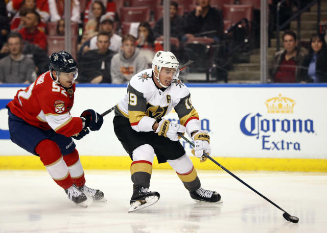 Vegas Golden Knights right wing Reilly Smith (19) skates to the net followed by Florida Panthers defenseman MacKenzie Weegar (52) during the first period of an NHL hockey game, Saturday, Feb. 2, 2019, in Sunrise, Fla. (AP Photo/Wilfredo Lee)
