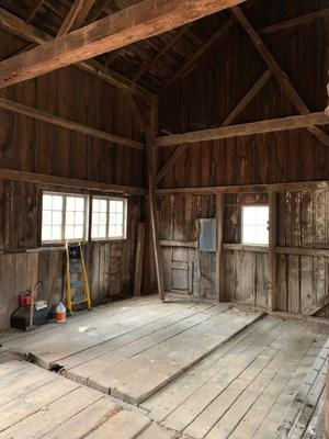A view from inside The Little White Barn in Saugatuck, Mich. before insulation and renovation.