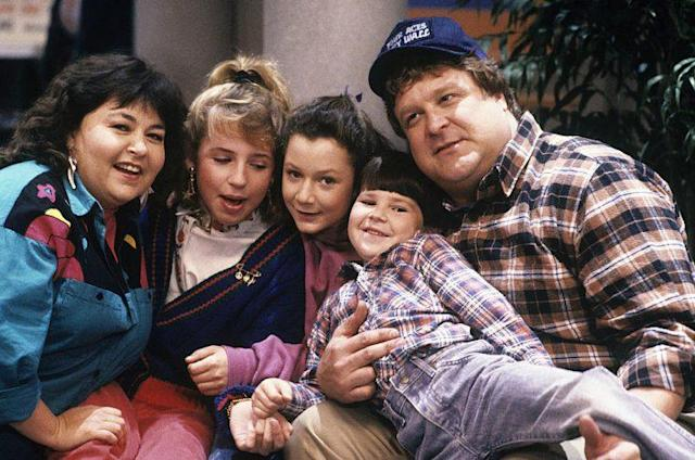 Roseanne Barr as Roseanne Conner, Alicia Goranson as Becky Conner, Sara Gilbert as Darlene Conner, Michael Fishman as D.J. Conner, and John Goodman as Dan Conner in 'Roseanne' (Photo: ABC/Getty Images)