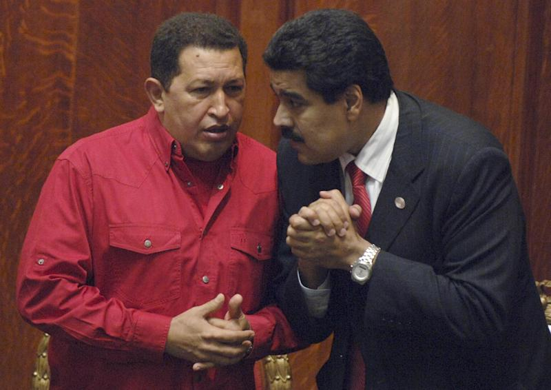 FILE - In this Dec. 18, 2007 file photo Venezuela's President Hugo Chavez, left, talks to his Foreign Minister Nicolas Maduro at the University of Uruguay in Montevideo, Uruguay. President Hugo Chavez on Wednesday, Oct. 10, 2012, named Nicolas Maduro as his new vice president. Maduro, a former National Assembly member, has headed the foreign ministry since 2006, and is seen as one of the administration's hard-liners. (AP Photo/Matilde Campodonico, File)