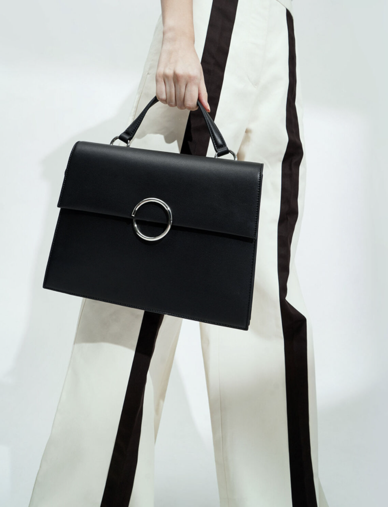 PHOTO: Charles & Keith. Ring Detail Large Top Handle Bag, S$69.90 (was S$99.90)