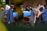 Relatives and friends carry the coffin of the late Argentine football legend Diego Maradona during his funeral at the Jardin Bella Vista cemetery, in Buenos Aires province, on November 26, 2020