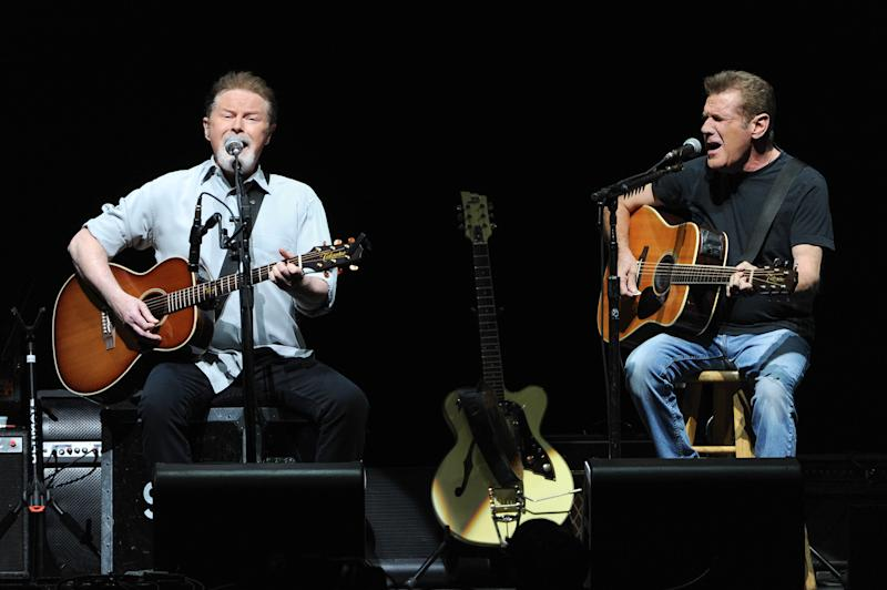 Musicians Don Henley, left, and Glenn Frey of the Eagles perform at Madison Square Garden on Friday, Nov. 8, 2013 in New York. (Photo by Evan Agostini/Invision/AP)
