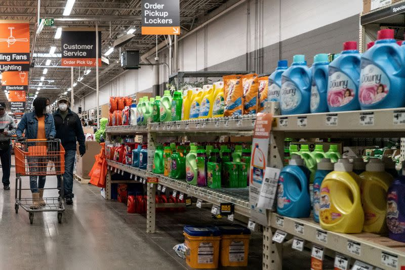 FILE PHOTO: Shoppers browse in a Home Depot building supplies store while wearing masks in St Louis