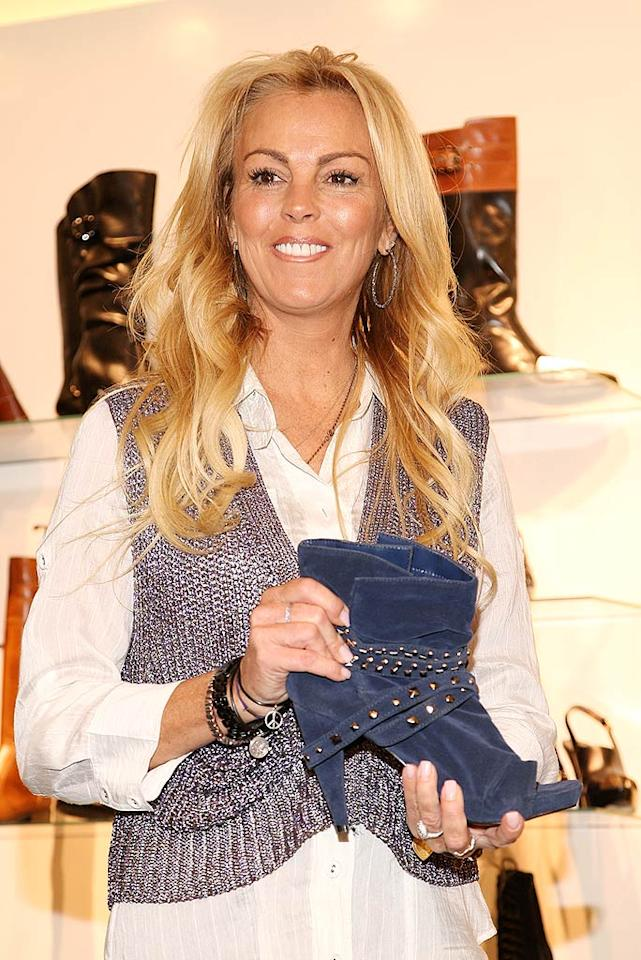 "Dina Lohan is launching her very own shoe line. You've been warned. Theo Wargo/<a href=""http://www.wireimage.com"" target=""new"">WireImage.com</a> - October 8, 2009"