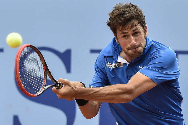 Robin Haase of the Netherlands returns a ball to Juan Monaco of Argentina during the semifinal match at the Swiss Open tennis tournament in Gstaad, Switzerland, Saturday, July 26, 2014. (AP Photo/Keystone,Peter Schneider)