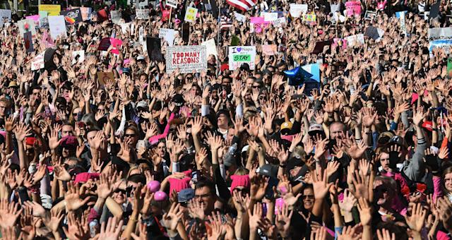 <p>Protesters, part of a 500,000 strong crowd, attend the Women's Rally on the one-year anniversary of the first Women's March in Los Angeles, Calif., on Jan. 20, 2018. (Photo: Mark Ralston/AFP/Getty Images) </p>
