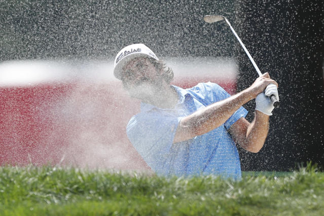 Mark Hubbard hits from sand onto the 11th green during the third round of the Rocket Mortgage Classic golf tournament, Saturday, July 4, 2020, at the Detroit Golf Club in Detroit. (AP Photo/Carlos Osorio)