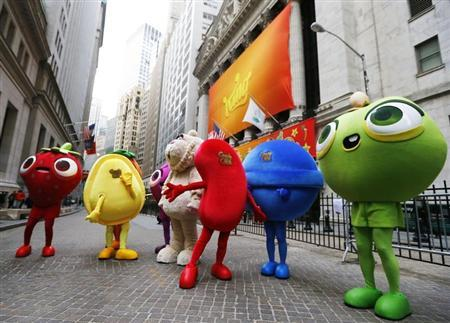 "Mascots dressed as characters from the mobile video game ""Candy Crush Saga"" pose outside the New York Stock Exchange ahead of the IPO of Mobile game maker King Digital Entertainment Plc March 26, 2014. REUTERS/Brendan McDermid"