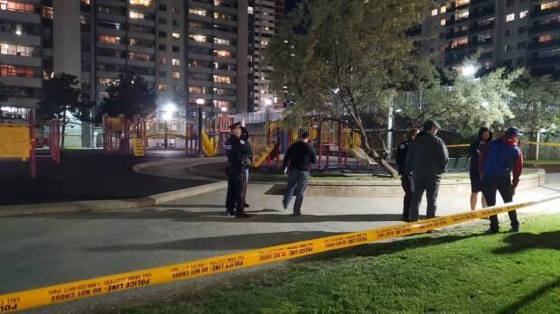 Emergency crews were called to the area of Wellesley Street East and Bleecker Street shortly before 9:30 p.m. for reports of shots fired and multiple people seen fleeing the area.  (Jeremy Cohn/CBC - image credit)