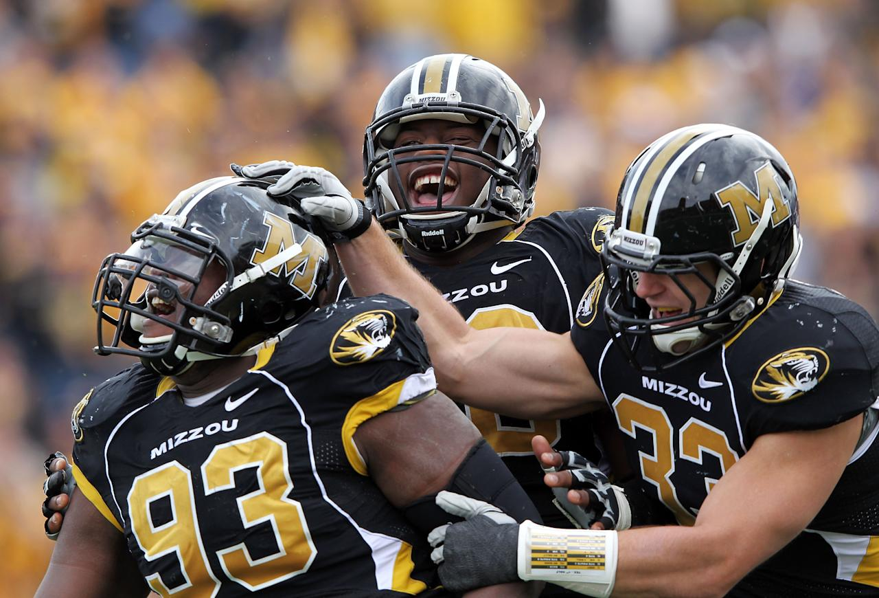 COLUMBIA, MO - NOVEMBER 12:  Terrell Resonno #93 of the Missouri Tigers is congratulated by teammates after sacking quarterback David Ash #14 of the Texas Longhorns during the game on November 12, 2011 at Faurot Field/Memorial Stadium in Columbia, Missouri.  (Photo by Jamie Squire/Getty Images)