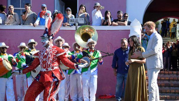 PHOTO: The Duke and Duchess of Sussex, Prince Harry and his wife Meghan, take part in Heritage Day public holiday celebrations in the Bo Kaap district of Cape Town, South Africa, September 24, 2019. (Toby Melville/Reuters)