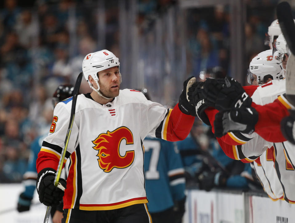 Calgary Flames' Dalton Prout (6) celebrates his goal with the bench against the San Jose Sharks in the first period of an NHL hockey game in San Jose, Calif., Sunday, March 31, 2019. (AP Photo/Josie Lepe)