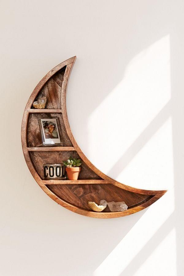 <p>They can store their knick-knacks on this <span>Crescent Moon Wall Shelf</span> ($89).</p>