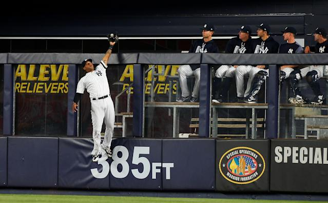 Aaron Hicks went all out to rob Wilson Ramos of a grand slam. (Photo by Jim McIsaac/Getty Images)