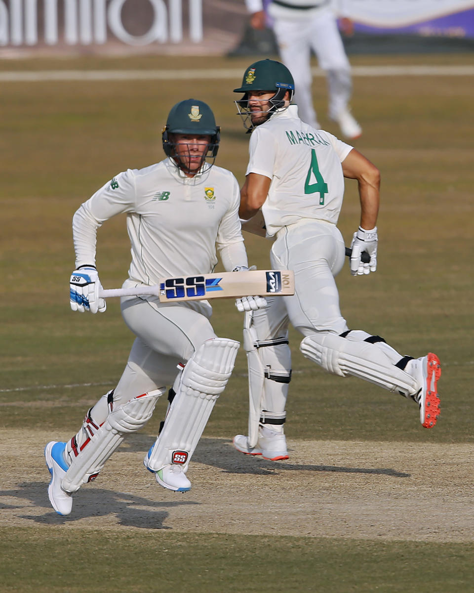 South Africa's Rassie van der Dussen, left, and Aiden Markram run between the wickets during the fourth day of the second cricket test match between Pakistan and South Africa at the Pindi Stadium in Rawalpindi, Pakistan, Sunday, Feb. 7, 2021. (AP Photo/Anjum Naveed)