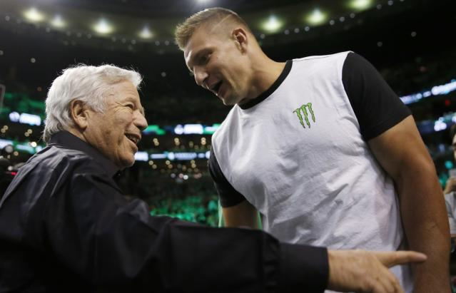 Usually the most tight-lipped team in the NFL, the New England Patriots, including owner Robert Kraft, left, and TE Rob Gronkowski, continue to find themselves in the headlines. (AP)