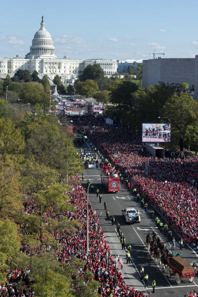 With the Capitol in the background, the MLB Washington Nationals celebrate the team's World Series baseball championship over the Houston Astros, with their fans in Washington, Saturday, Nov. 2, 2019. The Washington Nationals are getting a hero's welcome home from a city that had been thirsting for a World Series championship for nearly a century.(AP Photo/Cliff Owen)