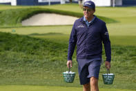 Phil Mickelson carries two buckets of balls as he heads to the range prior to a practice round before the U.S. Open Championship golf tournament, Tuesday, Sept. 15, 2020, at the Winged Foot Golf Club in Mamaroneck, N.Y. (AP Photo/Charles Krupa)