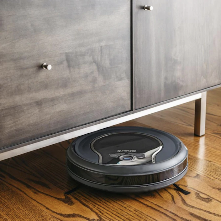 """Not only can this robotic vacuum clean on multiple surfaces, but it's easily controlled through a smartphone app as well as Amazon Alexa. $200, Lowe's. <a href=""""https://www.lowes.com/pd/Shark-Shark-ION-robot-vacuum-Blue-Robotic-Vacuum/1003020960"""" rel=""""nofollow noopener"""" target=""""_blank"""" data-ylk=""""slk:Get it now!"""" class=""""link rapid-noclick-resp"""">Get it now!</a>"""