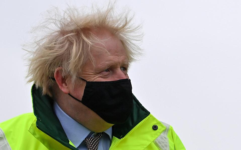 Boris Johnson visited some of the flood-hit communities in Manchester yesterday - Reuters