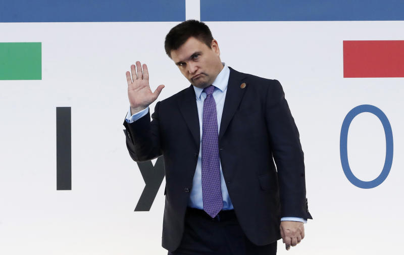 Ukraine's Foreign Minister Pavlo Klimkin arrives for the 25th Organization for Security and Co-operation in Europe, OSCE, ministerial council meeting, in Milan, Italy, Thursday, Dec. 6, 2018. (AP Photo/Antonio Calanni)