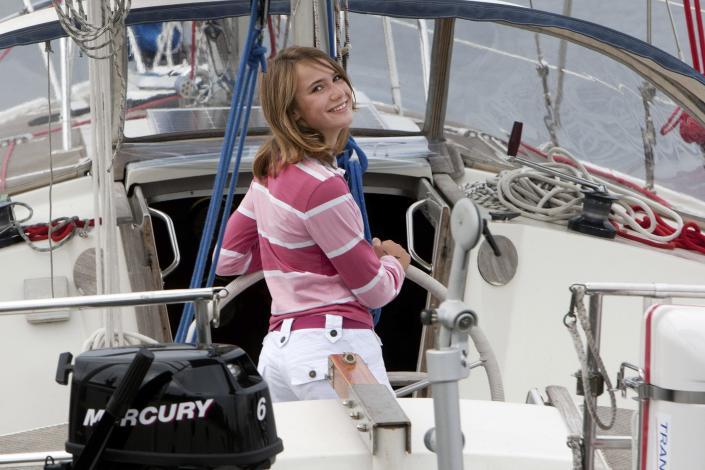 Laura Dekker poses for the media on her boat Guppy in Den Osse, south-west Netherlands, Tuesday, July 27, 2010. A Dutch court has cleared the way for 14-year-old Laura Dekker to set sail on a risky solo voyage around the world. Judges at Middelburg's family court have lifted a guardianship order imposed on Dekker last year after she said she wanted to set sail alone around the world. (AP Photo/ Evert-Jan Daniels)