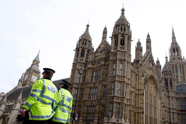 Police officers outside the Houses of Parliament. A Conservative MP has been arrested on suspicion of rape.