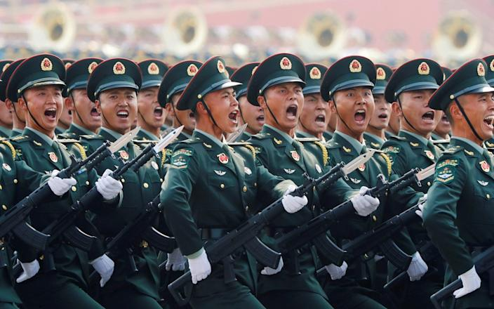 People's Liberation Army (PLA) soldiers march in platoon during a military parade commemorating the 70th anniversary of the Republic of China in 2019-THOMAS PETER & # xa0; / REUTERS
