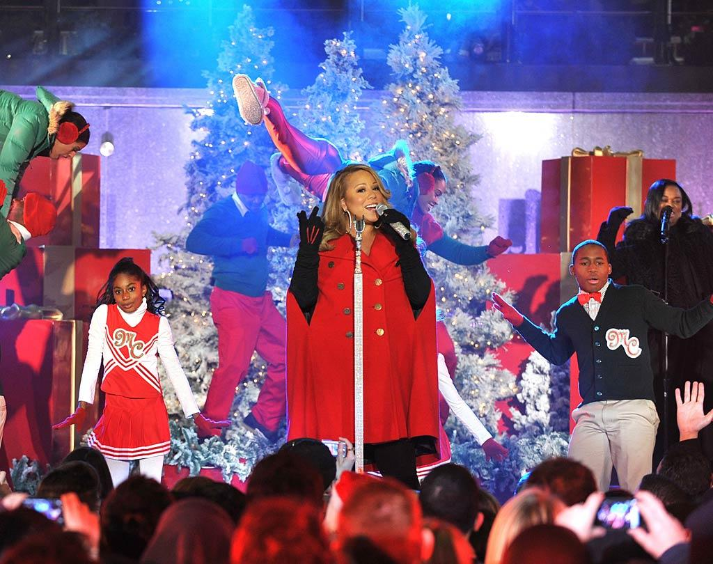 "Artfully hiding her baby bump under a festive red cape, Mariah Carey performed her latest holiday single ""Oh Santa!"" The singer -- who is expecting her first baby with husband Nick Cannon -- is currently playing coy about the rumor that she's having twins. Theo Wargo/<a href=""http://www.wireimage.com"" target=""new"">WireImage.com</a> - November 30, 2010"