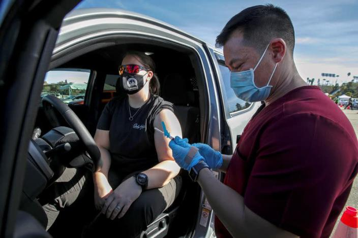 FILE PHOTO: COVID-19 mass-vaccination of healthcare workers takes place at Dodger Stadium
