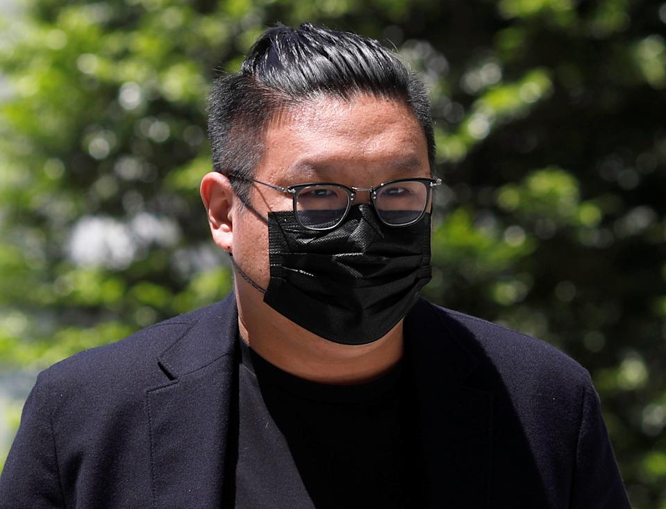 Ng Yu Zhi, a director of Envy Global Trading, arrives at the State Court in Singapore  April 20, 2021.  REUTERS/Edgar Su