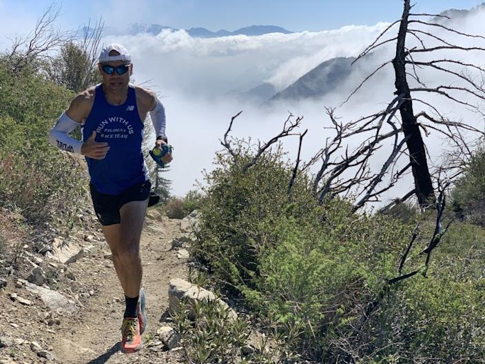 "Jerry Garcia runs at the San Gabriel Peak in the Angeles National Forest. In the background is Mt. Wilson. <span class=""copyright"">(Mayra Lopez-Garcia)</span>"