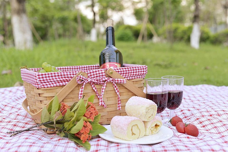 <p>The <span>Natural Woven Woodchip Picnic Basket with Double Folding Handles</span> ($18) is such a cute summer vibe. This adorable yet durable picnic basket is perfect for enjoying your meals in the great outdoors. </p>