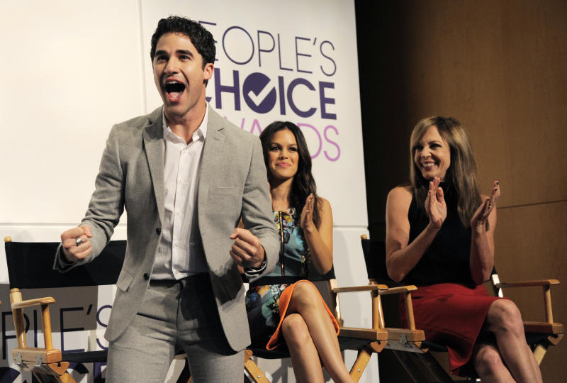 """Presenter Darren Criss, a cast member in the television series """"Glee,"""" reacts to his nomination for Favorite Comedic TV Actor during nominations for the 40th Annual People's Choice Awards at The Paley Center for Media on Tuesday, Nov. 5, 2013 in Beverly Hills, Calif. Looking on are fellow presenters Rachel Bilson, center, and Allison Janney. The show will be held on Jan. 8, 2014 at the Nokia Theater L.A. Live in Los Angeles. (Photo by Chris Pizzello/Invision/AP)"""