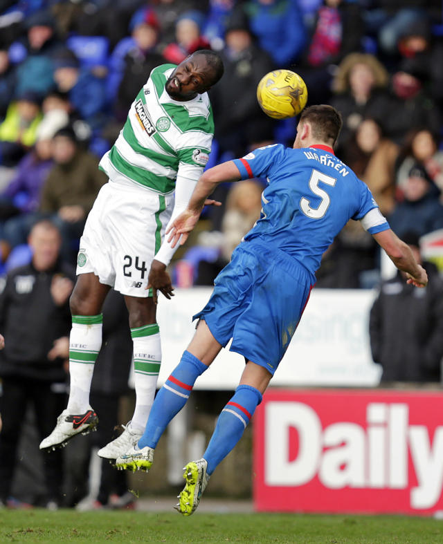 "Football Soccer - Inverness Caledonian Thistle v Celtic - Ladbrokes Scottish Premiership - Tulloch Caledonian Stadium - 29/11/15 Inverness Caledonian Thistle's Gary Warren (R) in action with Celtic's Carlton Cole Action Images via Reuters / Graham Stuart Livepic EDITORIAL USE ONLY. No use with unauthorized audio, video, data, fixture lists, club/league logos or ""live"" services. Online in-match use limited to 45 images, no video emulation. No use in betting, games or single club/league/player publications. Please contact your account representative for further details."