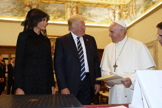 Pope Francis exchanges gifts with President Donald Trump and first lady Melania Trump at the Vatican on May 24. (AFP via Getty Images)
