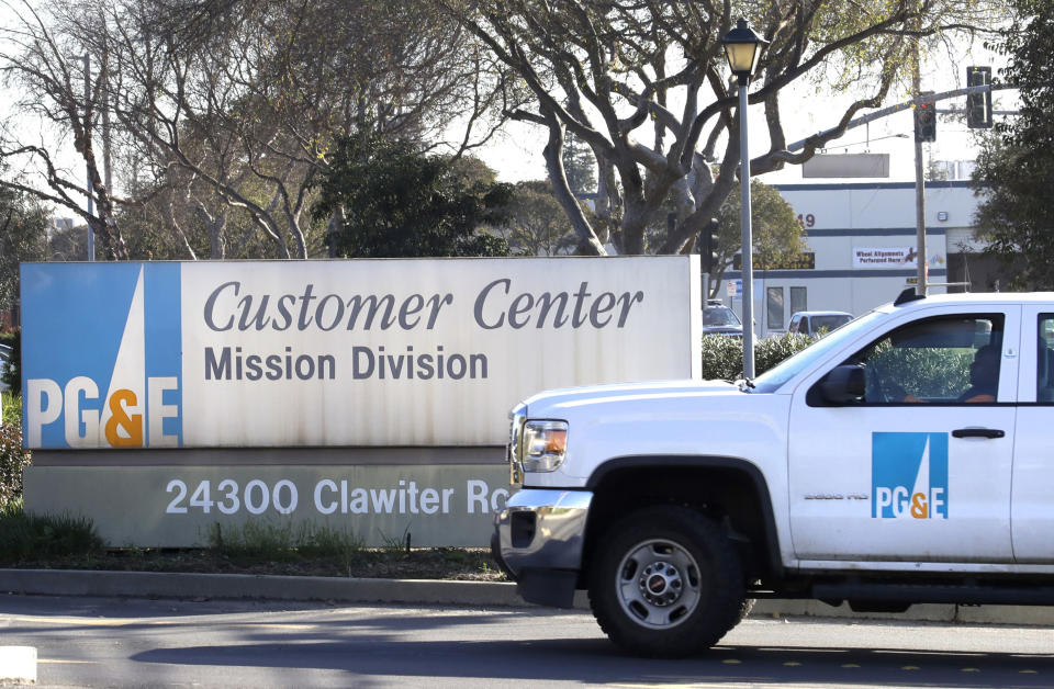 FILE- In this Jan. 23, 2019, file photo a Pacific Gas & Electric truck enters their customer center in Hayward, Calif. Pacific Gas & Electric Co. on Thursday, Nov. 7, reported a third-quarter loss of $1.62 billion, after reporting a profit in the same period a year earlier. (AP Photo/Ben Margot, File)